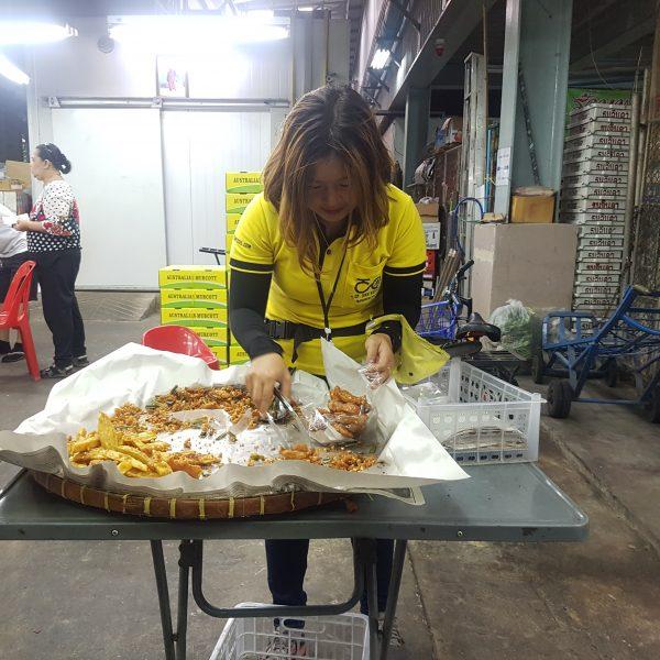 Sandra picking fried banana and sweet potato