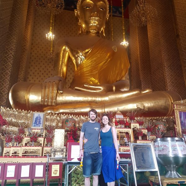 With the giant seated Buddah