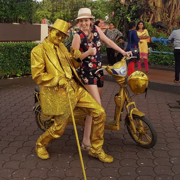 Posing with random gold man!