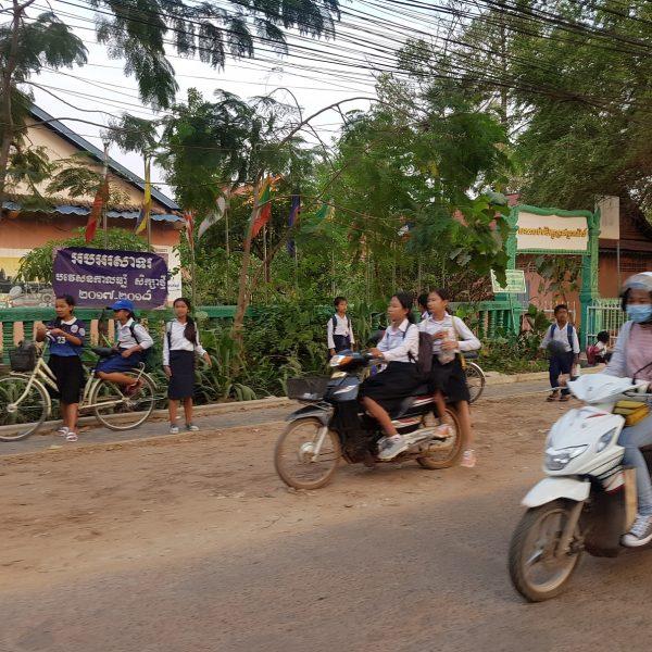 School kids scooting